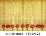 rose blossoms on a desaturated background from art deco windows - stock photo