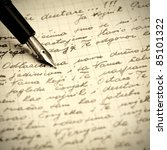 Old pen and letter .Close up photo. - stock photo