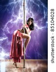 Young slim pole dance woman. Electric lightning effect. - stock photo