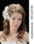 portrait of beautiful bride with flowers in hair on black - stock photo