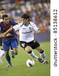 VALENCIA, SPAIN - SEPTEMBER 21:(R) Ever Banega with ball in the Spanish Soccer League between Valencia C.F. vs F.C. Barcelona - Mestalla Luis Casanova Stadium - Spain on September 21, 2011 - stock photo
