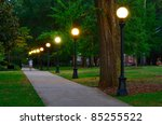 Stock photo historic college campus at dusk with lamp posts 85255522