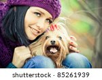 cute girl with small terrier dog - stock photo