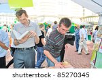 LVIV, UKRAINE - SEPTEMBER 15: Unidentified book sellers and shoppers among book stalls at the 18th Lviv International Book Fair on September 15, 2011 in Lviv, Ukraine. - stock photo