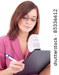 Portrait of a young businesswoman writing on a notebook - stock photo