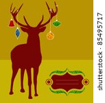 Christmas reindeer silhouette with decorations hanged from its antlers over mustard background. Ready for use as postage greeting card. - stock photo