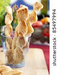 Dutch cheese sticks, kaastengels, in blue cup. - stock photo
