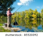 senior fisherman catches a fish ... | Shutterstock . vector #85520392