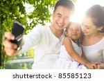 asian family taking photographs ...   Shutterstock . vector #85585123