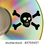 Part of cd with pirate sybol impressed - stock photo