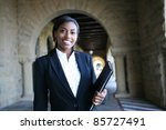 A young and pretty african american woman at college - stock photo