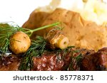 A grilled steak topped with fresh mushrooms and dill for dinner. - stock photo
