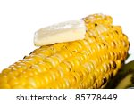 Farm fresh yellow corn on the cob with butter melting over the top. - stock photo