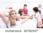 Relaxed young woman with family at home - stock photo
