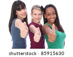 Thumbs up for success by three multi cultural teenage school student friends made up of mixed race african american, oriental Japanese and caucasian all happy holding hands out to camera. - stock photo