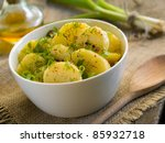 Potato salad with parsley, dill and olive oil. Selective focus - stock photo