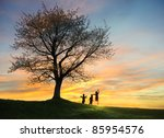 children playing in sunset ...