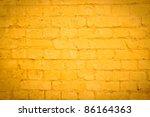 Vibrant Yellow Brick Wall As A...