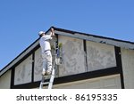 painter on a ladder uses brown... | Shutterstock . vector #86195335