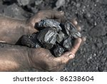 Small photo of Hands of the miner with coal