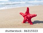 Red starfish on beach - Holiday concept - stock photo