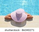 Beautiful woman enjoying at pool area - stock photo