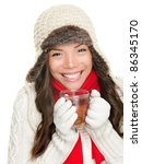 winter woman drinking tea wearing warm winter clothing, sweater, gloves and scarf. Beautiful mixed race asian caucasian girl model isolated on white background. - stock photo