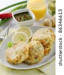 fish cutlets with pepper sauce and lemon - stock photo