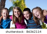 Happy children laughing and smiling together - stock photo