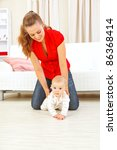 smiling mother helping cheerful ... | Shutterstock . vector #86368414
