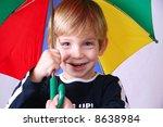 Kid with an umbrella - stock photo