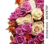 Multicolored roses packed tightly together - stock photo