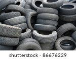 background with old tires on each other - stock photo
