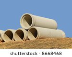 Concrete Drainage Pipe on a Construction Site - stock photo