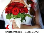 bride  who holds a bouquet of... | Shutterstock . vector #86819692
