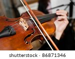 Closeup Of A Woman Playing The...