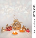 Burning candles in a Christmas setting with seasonal decorations - stock photo