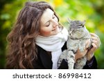 Stock photo young girl with cat on natural background 86998412