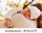 Sleeping Little Girl On Mother...