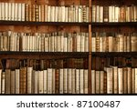 old books on a shelf - stock photo