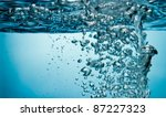 bubbles underwater from splashing water - stock photo