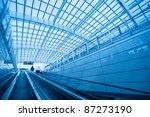 escalator in modern interior airport - stock photo