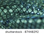 abstract blue and green reflective background with selective focus - stock photo