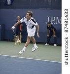 NEW YORK - SEPTEMBER 01: Richard Gasquet of France returns ball during 2nd round match against Ivo Karlovic of Croatia at US Open on September 01, 2011 in NYC - stock photo