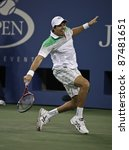 NEW YORK - SEPTEMBER 01: Carlos Berlocq of Argentina returns ball during 2nd round match against Novak Djokovic of Serbia at USTA Billie Jean King National Tennis Center on September 01, 2011 in NYC - stock photo