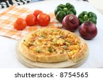 vegetarian pizza with tomatoes  ...