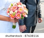 bride holding wedding bouquet and groom - stock photo