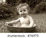 baby splashing in a basin in sepia - stock photo