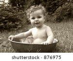Baby Splashing In A Basin In...
