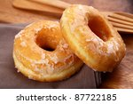 a sugar glazed donut on wood | Shutterstock . vector #87722185